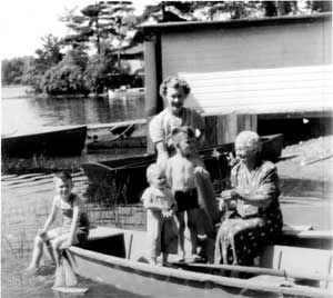 Tom, Ruth, and John Gough with their mother and Aunt Margaret Washburn, circa 1952. Footloose Island in background.